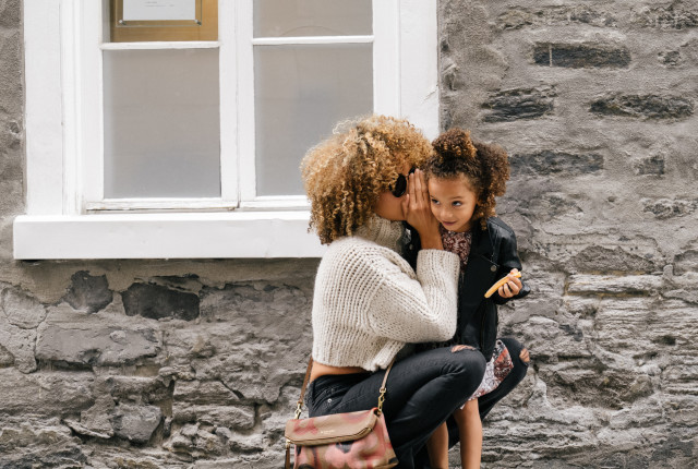 mom whispering unsplash.com